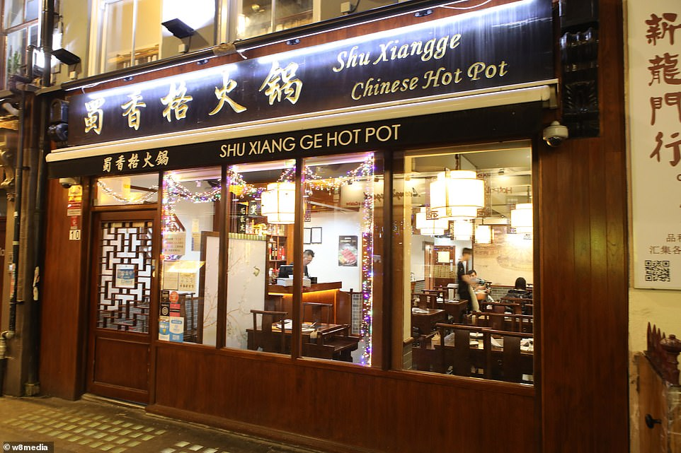 A 54-year-old Taiwanese market stall holder in Aberystwyth, West Wales, has said other stallholders tried to turf her out and told her to 'go home'. Pictured: A nearly deserted restaurant in China Town.There is no suggestion that restaurant staff are infected by the virus