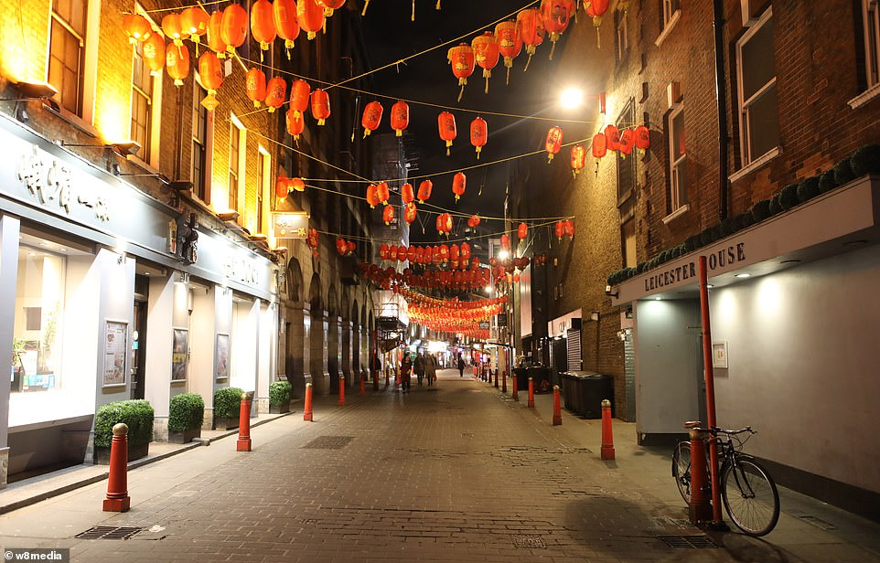 Ms Lu said a group of them had held a meeting and decided to try and ban her from returning to her stall over fears she would 'put them all at risk' of catching the virus. Pictured: Nearly deserted streets in London's China Town