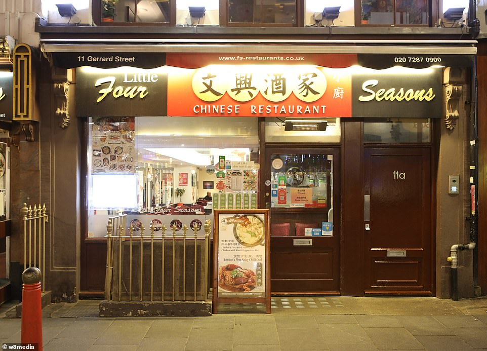 The first person died that week and, by January 16, two were dead and 41 cases were confirmed. The next day, scientists predicted that 1,700 people had become infected, possibly up to 7,000. Pictured: A nearly empty restaurant in China Town.There is no suggestion that restaurant staff are infected by the virus