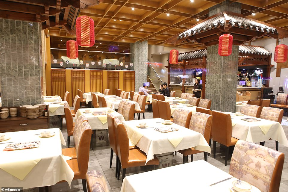 Just a week after that, there had been more than 800 confirmed cases and those same scientists estimated that some 4,000 – possibly 9,700 – were infected in Wuhan alone. By that point, 26 people had died. Pictured: An almost empty restaurant in China Town.There is no suggestion that restaurant staff are infected by the virus