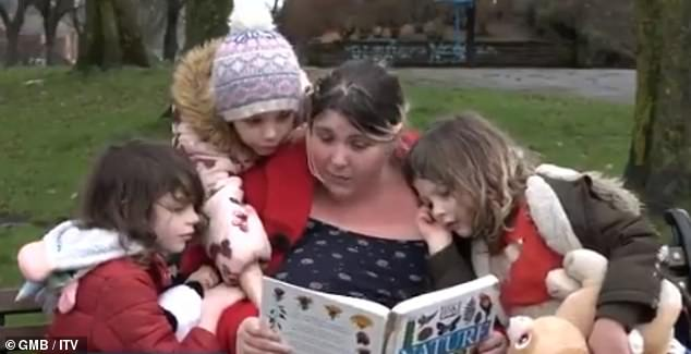 Nic Bescoby, from Rochdale, pictured reading with her three children George, 8, and Ellie, 7, and young Amy