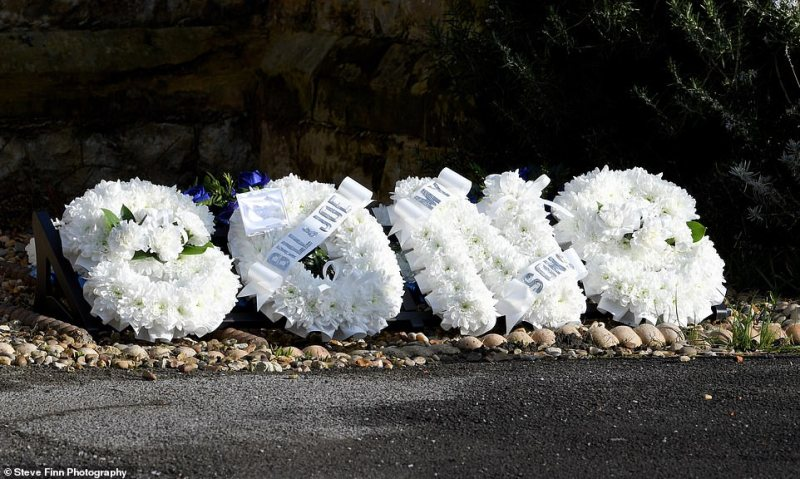 Floral tributes are pictured on the edge of the road where a funeral procession took place in Sevenoaks, Kent this morning