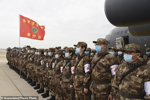 Chinese military medics arrive at the Tianhe International Airport in Wuhan, central China's Hubei Province on Thursday