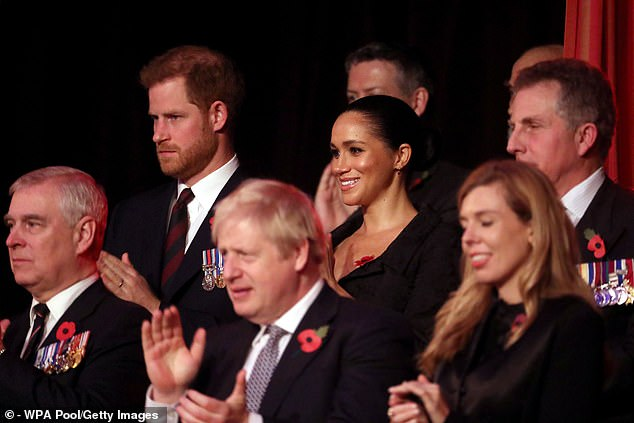 It is believed Prince Andrew, pictured left at the annual Royal British Legion Festival of Remembrance in November, will still walk his daughter Princess Beatrice down the aisle at her wedding at the Chapel Royal in St James's Palace on May 29