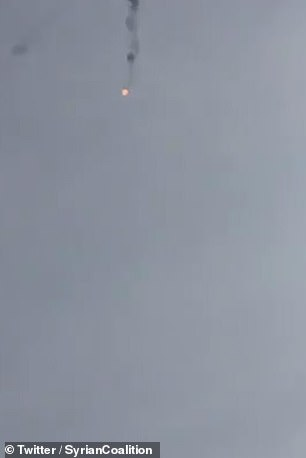 The burning helicopter falls from the sky in footage published by the Syrian rebels today