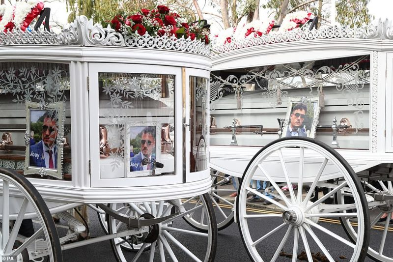 The two carriages decorated on the inside with framed photographs of the brothers so mourners could tell them apart