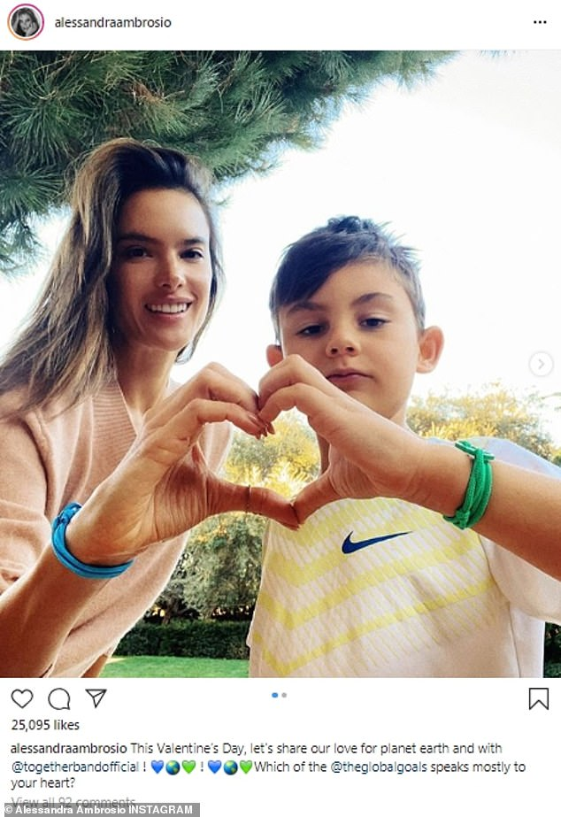 From her heart: Model Alessandra Ambrosio posed with her son Noah, aged seven, as the two made a heart shape with their hands
