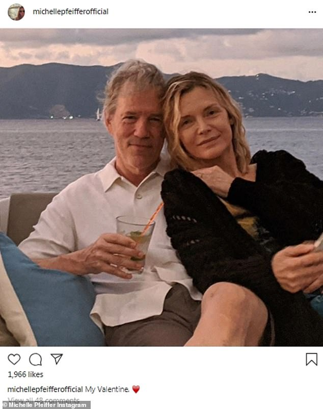 True love:Michelle Pfeiffer, 61, of Maleficent fame shared a very sweet image.The iconic actress, who played an ice queen in Scarface, posed with her husband, Hollywood writer and director David E Kelley who worked on Big Little Lies