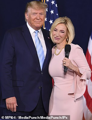 Trump was accompanied by his faith adviser Paula White, who stirred up controversy last month after calling for 'all satanic pregnancies to miscarry'