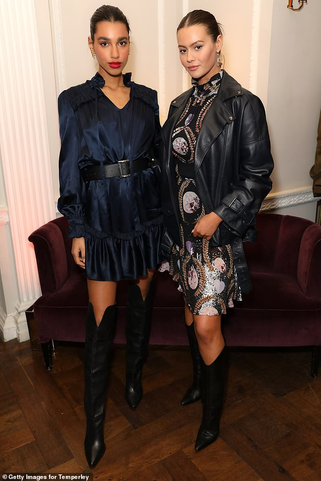 Dynamic duo:Influencers Chiara Sampaio and Jordan Grant upped the glamour ante in black knee high boots and high neck mini dresses