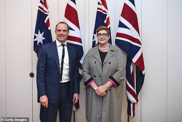 UK Foreign Secretary Dominic Raab (L) and Australian Foreign Minister Marise Payne pose for photographs ahead of a bilateral meeting at Parliament House on February 6 in Canberra