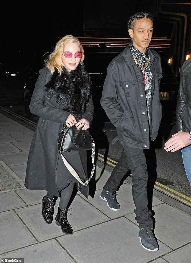 Dinner date: The pop legend, 61, was certainly feeling the love for her toyboy, 25, as they stepped out of the Chiltern Firehouse in central London
