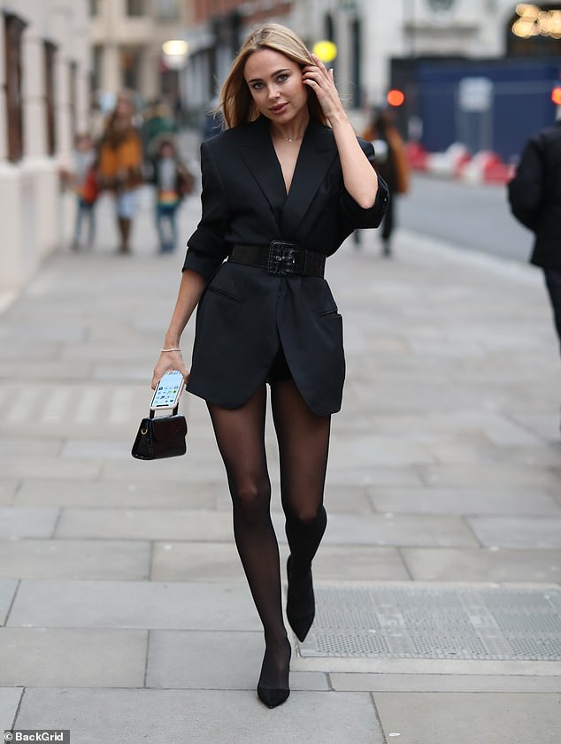Stylish: Kimberly Garner gave a very leggy display as she arrived at London Fashion Week for Atelier Zuhra's show