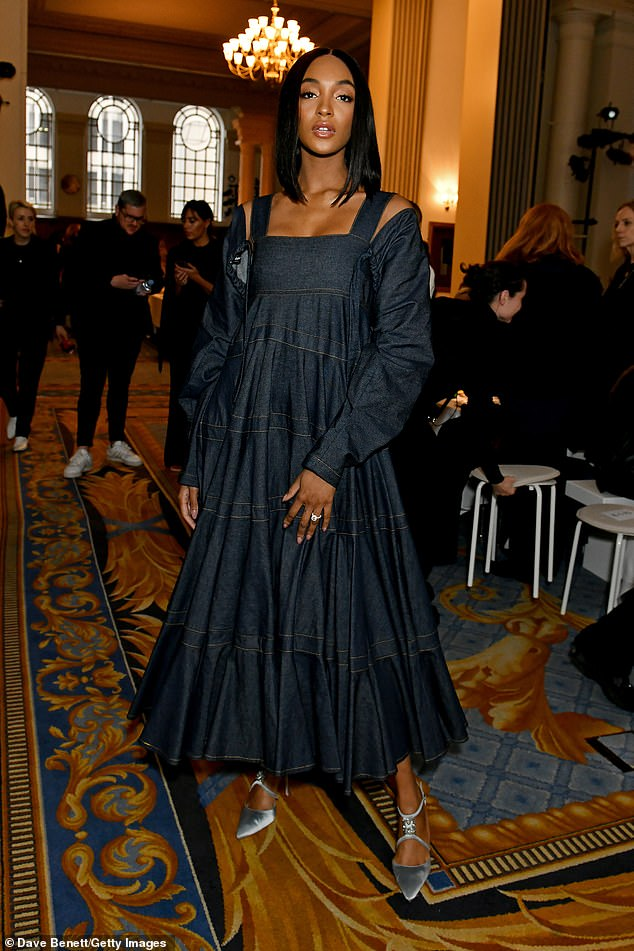 Glamorous: Newly-engaged Jourdan Dunn looked stylish in a denim maxi dress as she flashed her sparkling diamond ring at glitzy London Fashion Week show on Saturday