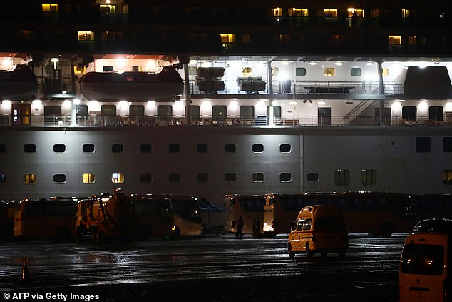 Multiple buses parked near the cruise ship were ready to ferry American passengers from the vessel to an airport late Sunday
