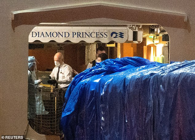 Diamond Princess officials could be seen on board the ship just before the evacuation of the American passengers began