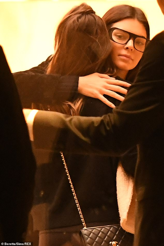 Bookish beauty: Kendall Jennersported a bookish look Sunday in a pair of groovy black eyeglasses as she met up with a friend at London Fashion Week