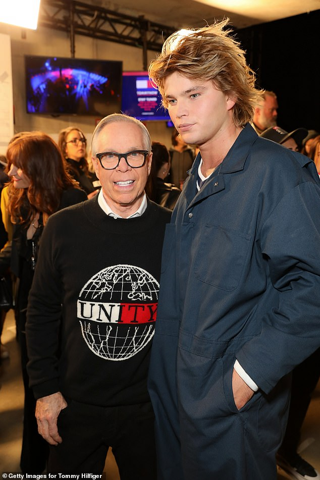 Fancy seeing you here!The catwalk king smoldered on the runway, before later posing with Tommy Hilfiger himself at the show