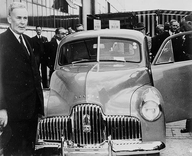 The axing of the Holden nameplate will end a motoring tradition that began in November 1948 when the first 48-215 rolled off the production line at the Fisherman's Bend factory in Melbourne. Pictured is then Labor prime minister Ben Chifley with the first-ever model