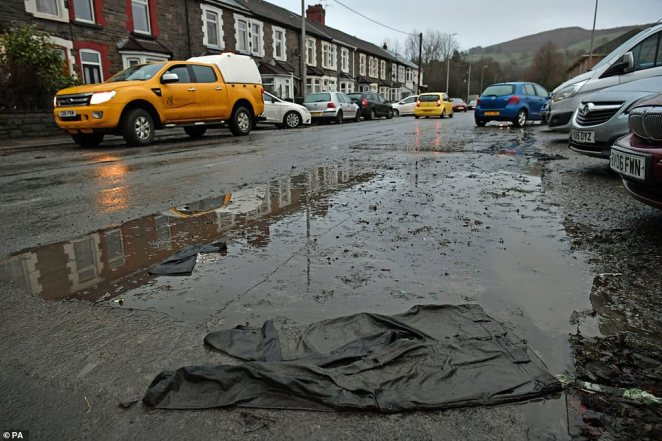 Nantgarw, in south Wales, where residents are returning to their homes to survey and repair the damage in the aftermath of Storm Dennis