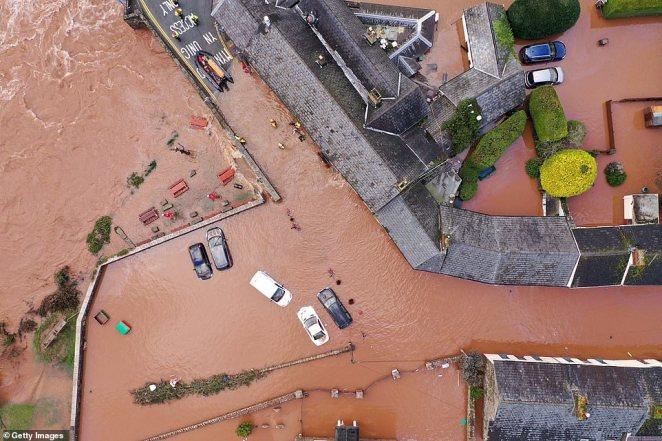 Shocking drone pictures show the devastating scale of flooding the Welsh village of Crickhowell after the River Usk burst its banks