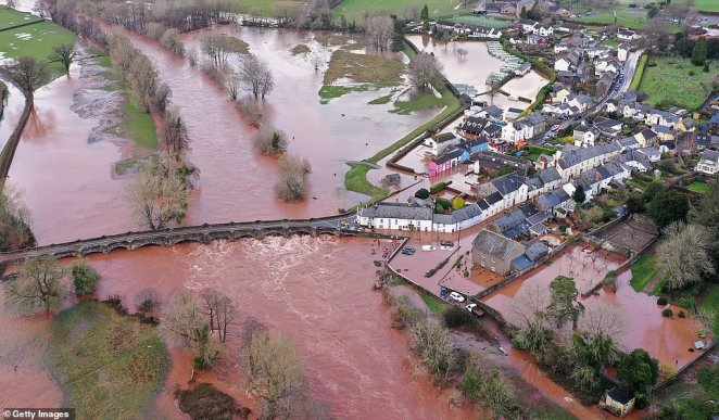 The devastating impact of the floods is seen in shocking aerial pictures from the Powys village of Crickhowell after the River Usk burst its banks