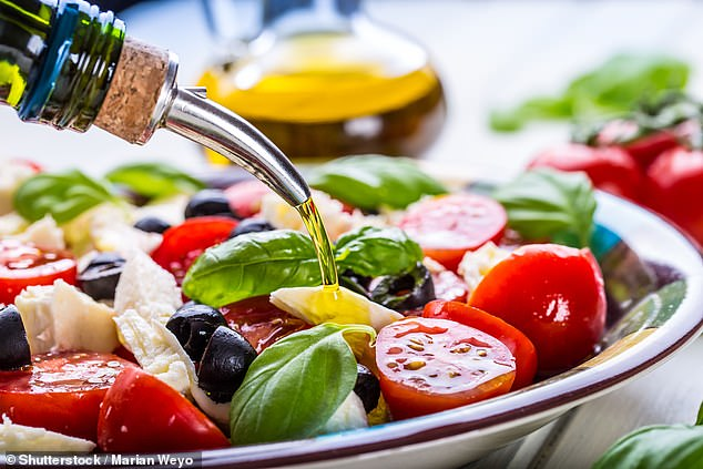 The traditional Mediterranean diet includes lots of vegetables, fruits, beans, and is abundant in healthy fats like olive oil (pictured)