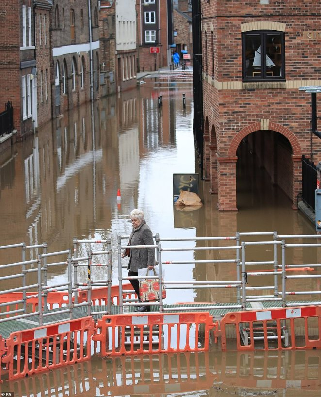 Special walkways have been erected in York as the city braces itself for even more rain after the River Ouse burst its banks