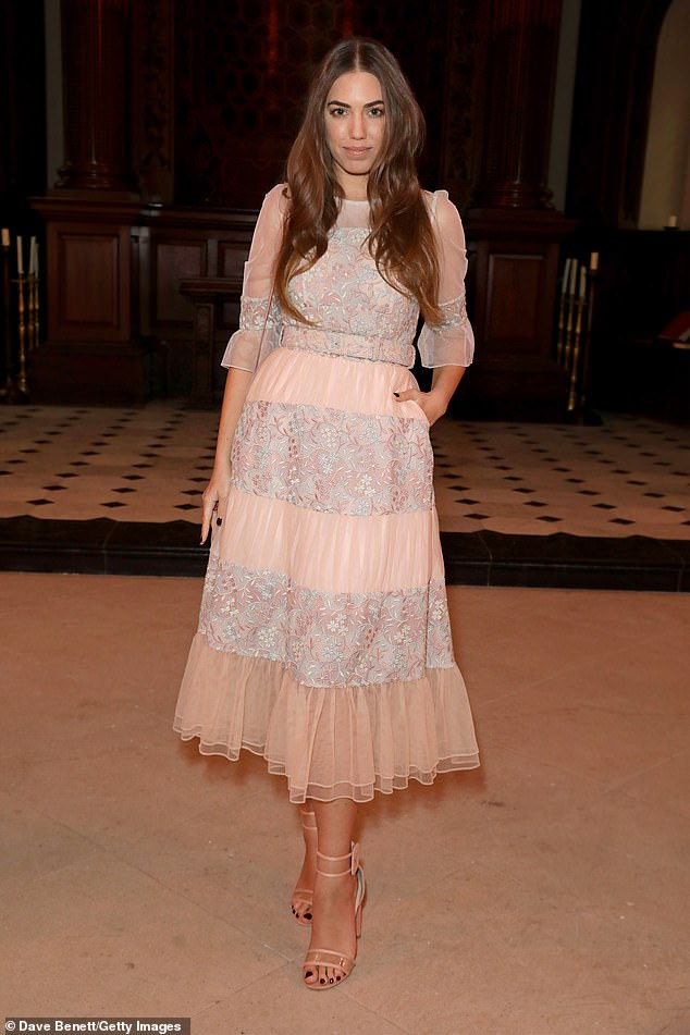 Charming: Amber Le Bon, 30, looked every inch the flawless fashionista in an elegant peach gown at BORA AKSU's London Fashion Week show in Bloomsbury on Monday