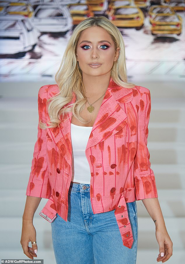 Turning heads: Other fashionistas attending Irish designer Paul Costelloe's show included YouTube star Saffron Barker, 19, who looked pretty in pink