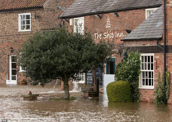 The Ship Inn in Acaster Malbis, near York, is pictured inaccessible after being inundated by floods during Storm Dennis