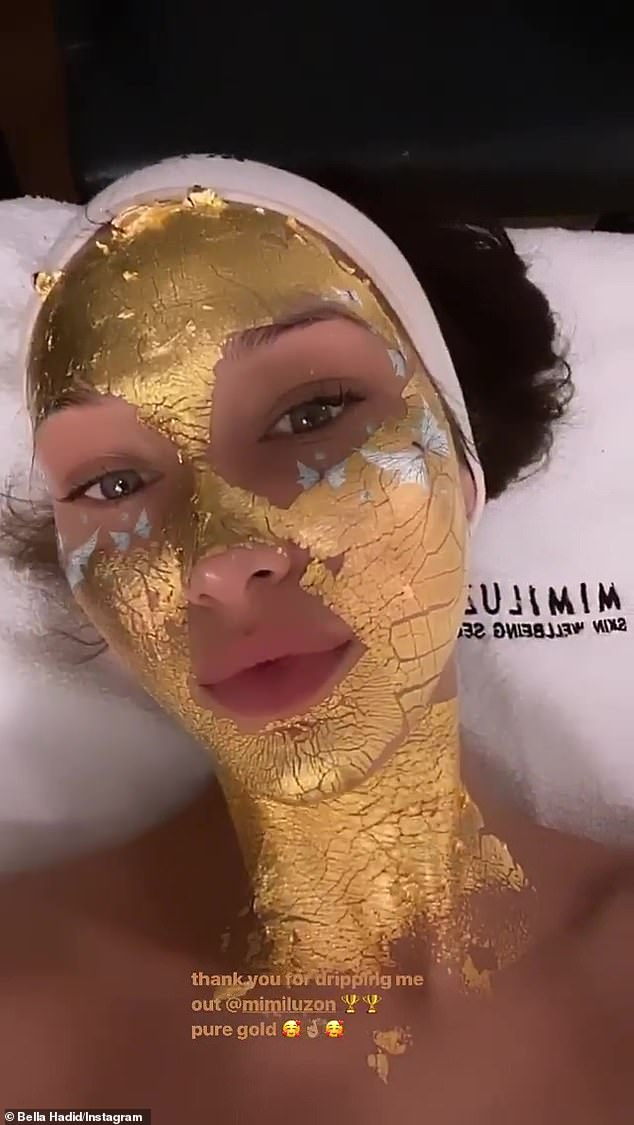 Golden girl: Bella Hadid prepared for London Fashion Week by getting a 24k-gold face treatment