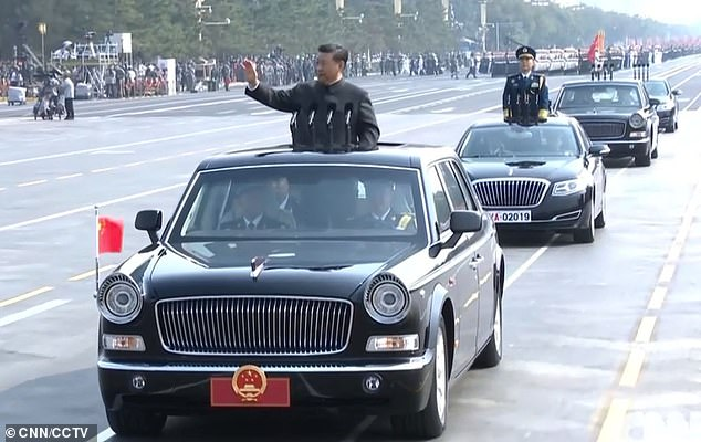 President Xi Jinping arrives during a military parade for the 70th anniversary of the CCP