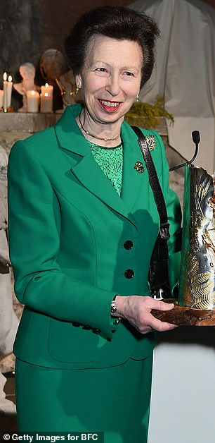 Princess Anne shunned the fashion week trend of showcasing new season designs and instead stayed true to her thrifty nature with a favourite green suit