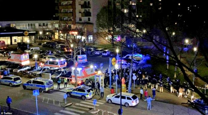 Emergency service swarmed the area after the shooting. A silver Mercedes covered with rescue blankets was seen in front of a bar in Hanau