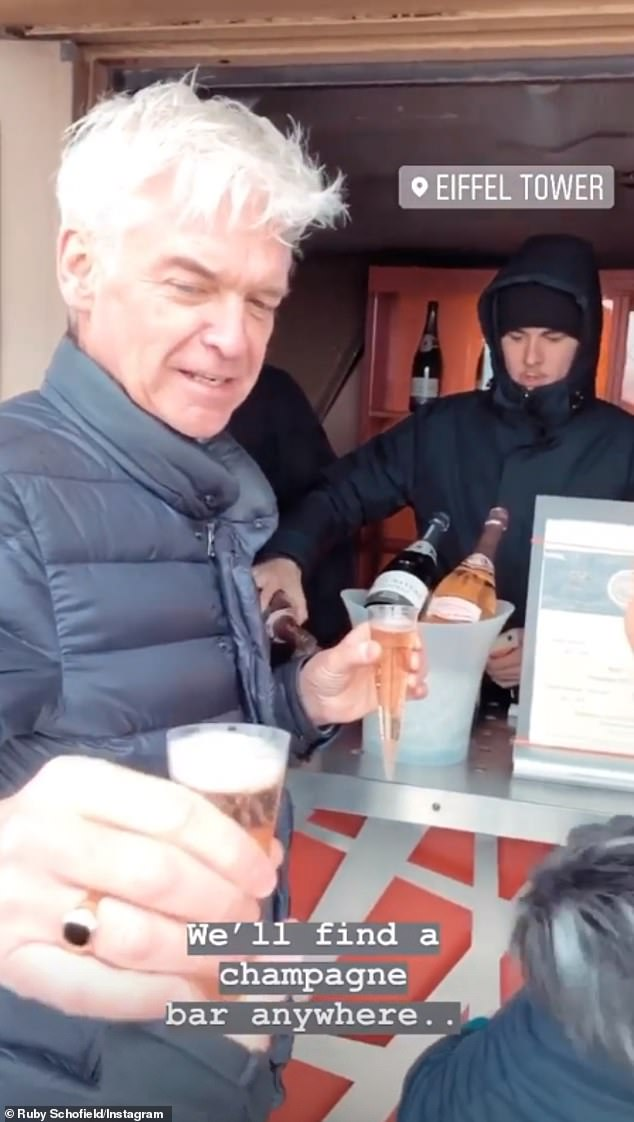 Sweet:Phillip appeared to be having the time of his life on the trip, where his daughter Ruby shared videos of the group drinking champage at the top of the Eiffel Tower