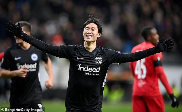 Frankfurt forward Daichi Kamada celebrates scoring his hat-trick goal against RB Salzburg