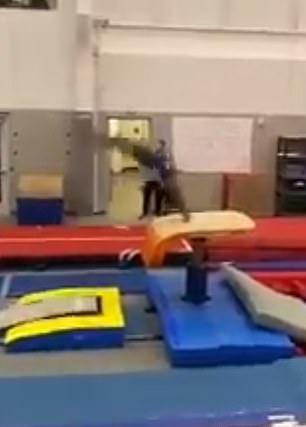 In the five-second clip, Simone is like a flash of lightning as she runs and does a round-off onto the springboard, a back handspring onto the vault (pictured), and two flips