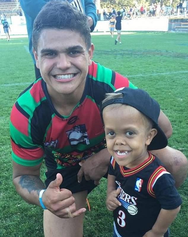 Quaden is pictured with NRL star Latrell Mitchell. The nine-year-old will lead the Indigenous All Stars NRL team onto the pitch on Saturday