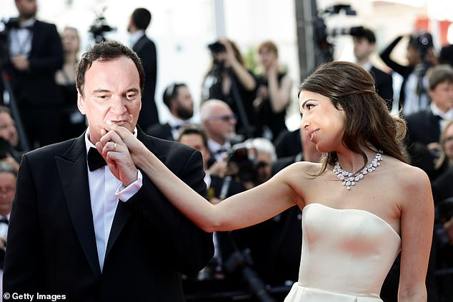 Taking their time: They met in 2009 while Tarantino was promoting Inglourious Basterds in Israel, though they didn't start dating until 2016. The two were engaged in 2017 and married the following year; shown in July