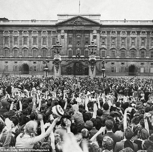 Crowds cheer as King George VI and Queen Elizabeth with Princess Elizabeth and Princess Margaret appear on the balcony on May 8, 1945.Now, 75 years on, the whole country is preparing to celebrate all over again