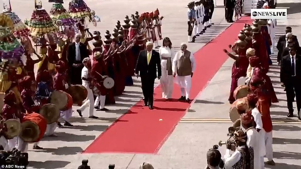 It was a festive arrival ceremony with music and dancers in native costume greeting the party as they walked the red carpet