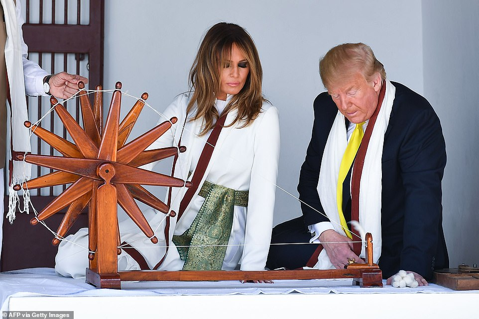 President Trump and Melania Trump - who donned prayer shawls and removed their shoes - visited the home of Gandhi where Trump tried his hand at the loom