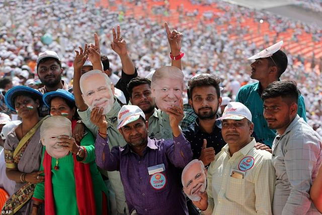 Supporters at the Sardar Patel Stadium waved Trump and Modi masks