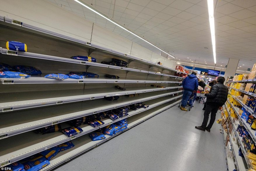 The woman travelled from Bergamo, in the now-quarantined Lombardy region, before the lockdown was put in place before falling ill in Palermo (pictured, empty supermarket shelves)