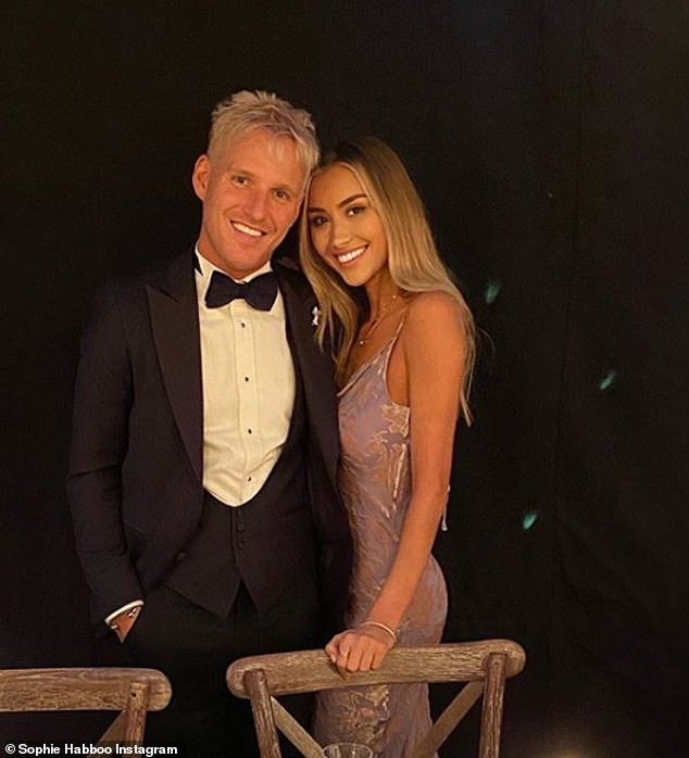 Star-studded! Made in Chelsea's Sophie Habbo shared an image with her boyfriend Jamie Laing as she sported a purple dress to the society do