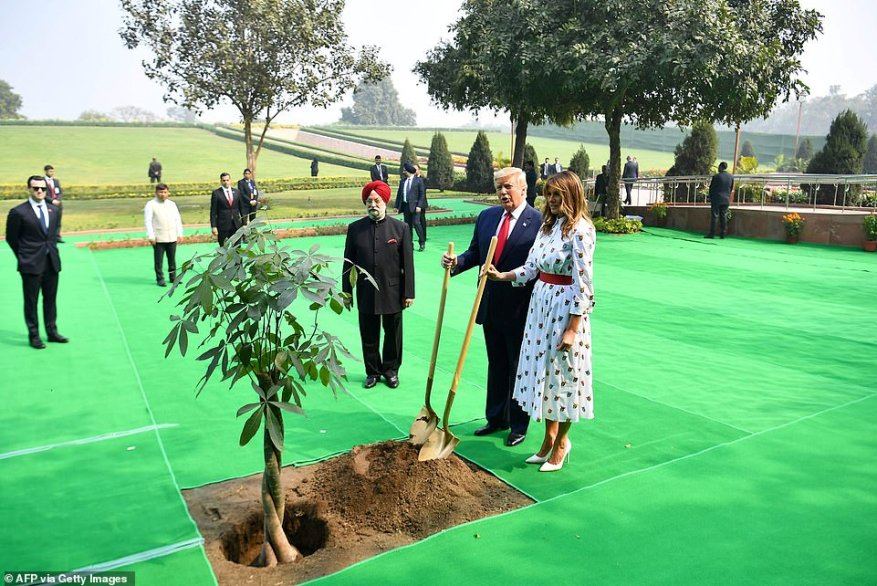 President Donald Trump and First Lady Melania Trump plant a tree in the gardens near Gandi's memorial