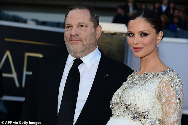 Producer Harvey Weinstein and his former wife Georgina Chapman arriving on the red carpet for the Annual Academy Awards in Hollywood in 2013