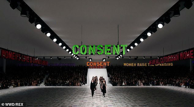 Models kicked off the Christian Dior for Paris Fashion Week surrounded by neon signs with the messagers 'Patriarchy kills love' 'consent', 'Women's love is unpaid labour' and 'We are all clitoridian women', referencing feminist Carla Lonzi, co-founder of the Feminine Revolt