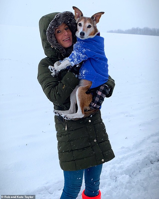 Kate says that leaving Poppy is unbearable, because the pup suffers from separation anxiety (pictured on a snowy day away)